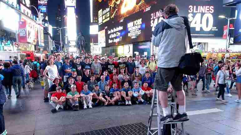 A school group visiting Times Square